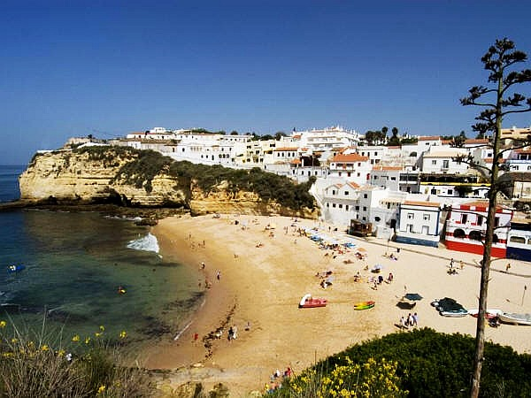 Carvoeiro, Algarve with a view over the beach on a sunny day.